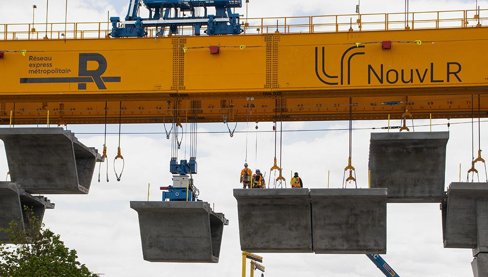 Workers on a launching beam as part of the REM project